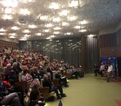 Almost full, the auditorium seats 280